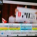 写真: 視聴中の番組表確認
